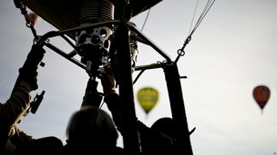 People on board a hot air balloon