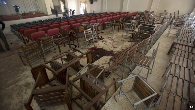 Upturned chairs and blood stains on the floor of the school in Peshawar on 17 December 2014