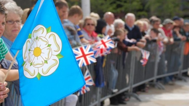 Person holding Yorkshire flag