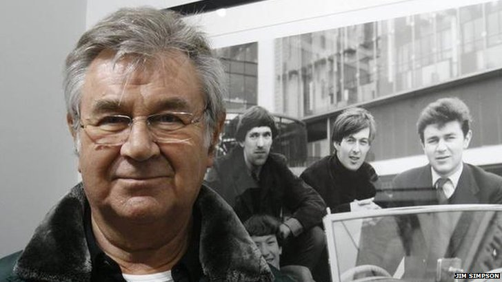 Pete York next to a picture of himself in The Spencer Davis Group