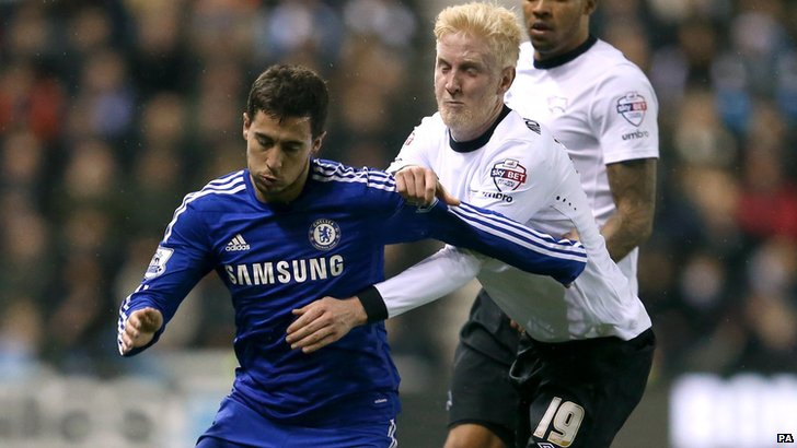 Will Hughes tussles with Eden Hazard
