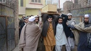Pakistani mourners carry a coffin during the funeral ceremony for victims of an attack by Taliban militants at an army-run school, in Peshawar on 17 December  2014.