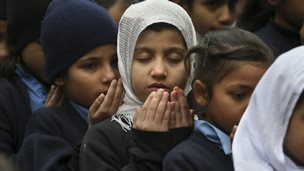 Pakistani students pray during a special ceremony for the victims of Tuesday's attack in Peshawar, at a school in Lahore - 17 December 2014