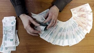 Man counting roubles