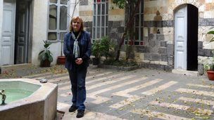 Diana Darke in the courtyard of her house