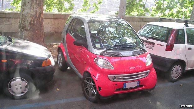 Smart car parked perpendicular