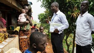 A disease surveillance officer working for Operation Western Area Surge. visits a family in Moyinba, Sierra Leone