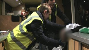 A drunk man being treated