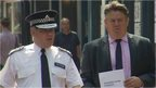 Police officer with London Deputy Mayor for Policing and Crime Stephen Greenhalgh