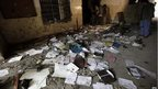 Workbooks scattered across the floor at the school in Peshawar