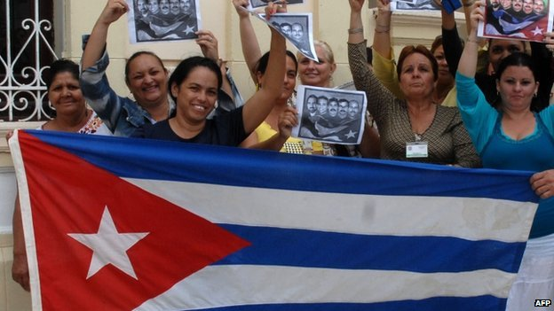 Cubans celebrate release of prisoners with national flag in Camaguey, east of Havana. 17 Dec 2014