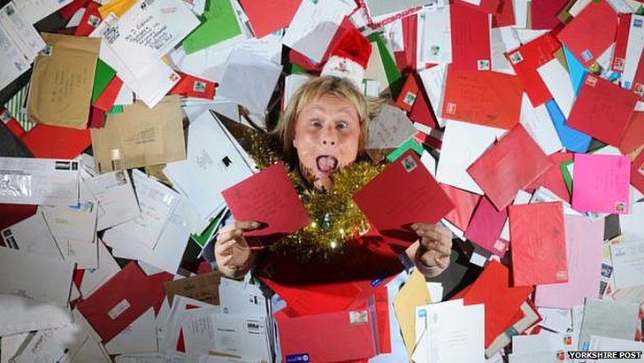 Woman surrounded by Christmas cards