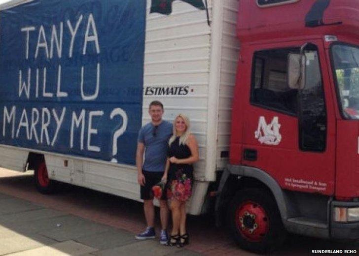 Couple in front of van
