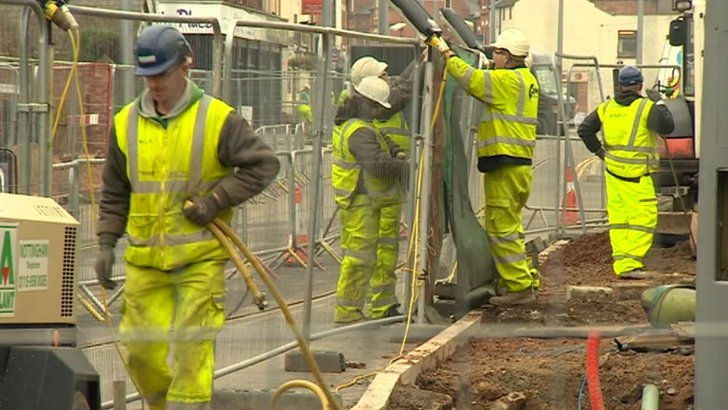 Men working on tramline in Beeston