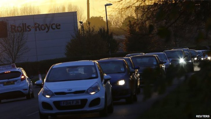 Workers drive from Rolls-Royce in Derby on the day of the announcement