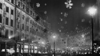 30th November 1955: Christmas decorations in Regent Street, London, consisting mainly of snow crystal stars made of aluminium to give the effect of a snowstorm.