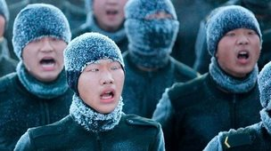 Chinese soldiers parade in very cold temperatures