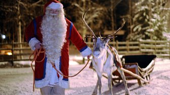 (File photo) A man dressed as Father Christmas with a sleigh and a reindeer
