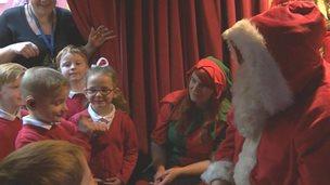Santa signing to children