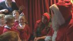 Santa signing to children