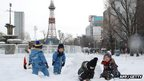 Children play in the deep snow in Japan
