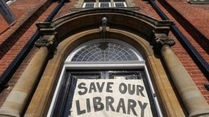 Save our library sign