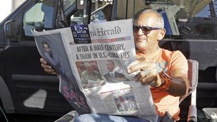 Man in Miami reads news