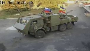 CCTV image of men in an armoured truck