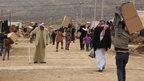 Displaced Iraqi people from the minority Yazidi sect, fleeing violence in the Iraqi town of Sinjar