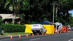 Police attend the scene of multiple deaths in the suburb of Manoora on 19 December 2014 in Cairns, Australia