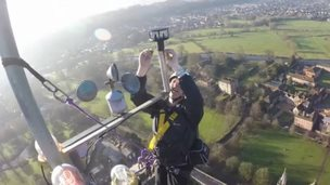 Worker at the top of the Salisbury Cathedral spire