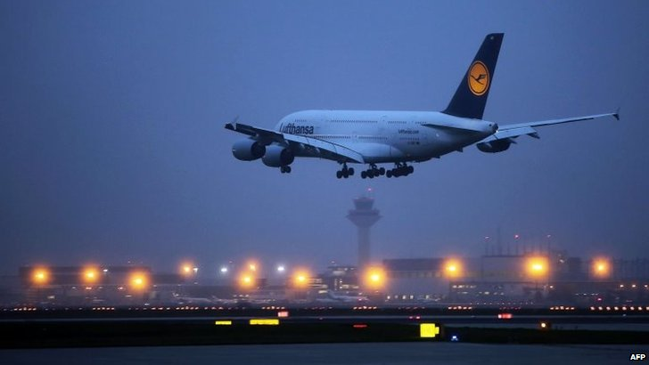 A plane of German airline Lufthansa landing at the airport in Frankfurt