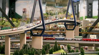 Models of roads and cars on a bridge