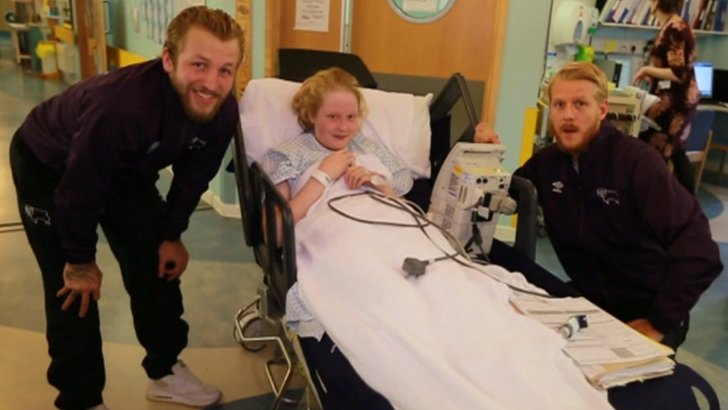 Derby County players with patient