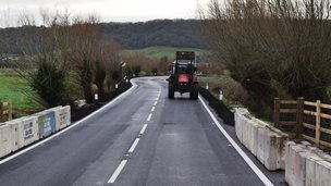 The first vehicle to pass along the reopened A372