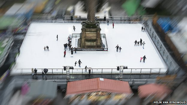 The ice rink in focus; stalls around it blurred