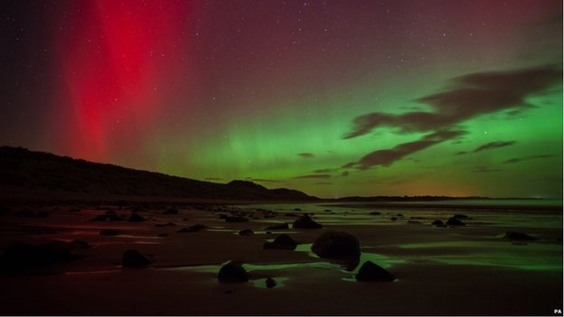 The Northern lights as seen from a beach