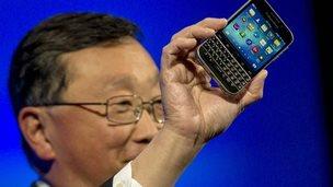 John Chen holding Blackberry Classic