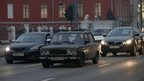 Lada car driving down street in Moscow