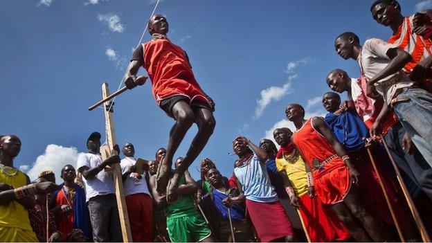 A Maasai warrior makes the high jump in the Maasai Olympics