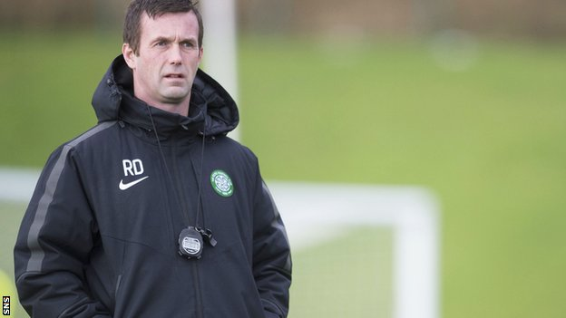 Ronny Deila watches training