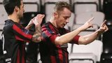 Declan caddell congratulates Crusaders goalscorer Timmy Adamson