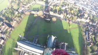 Workers at the top of Salisbury Cathedral's spire