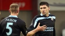 Ballymena players congratulate Davy Munster after he scored the opening goal