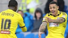 Brentford's Andre Gray celebrates with Moses Odubajo after scoring the second goal