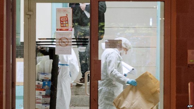 Forensic police collect evidence inside Joue les-Tours' police station. Photo: 20 December 2014