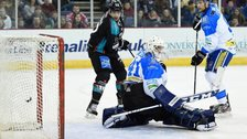 Ray Sawada diverts in Belfast's second goal past Coventry keeper Brian Stewart in Saturday's Elite League game