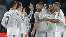 Real Madrid players celebrate their opener against San Lorenzo