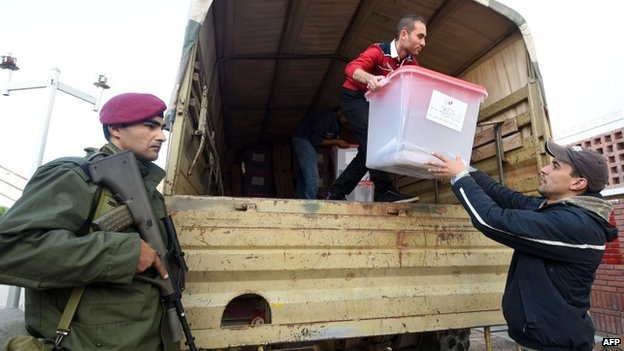 A Tunisian army officer oversees the delivery of a ballot box in preparation for the presidential run-off election