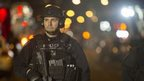 A police officer guards the shooting scene in New York, 20 December